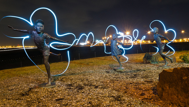 "This was taken at the DFW observation park named ""Founder's Plaza."" north of the airport. I was there for a photography club meetup to shoot the planes as the landed. After it got dark, it was hard to shoot the planes. I saw these sculptures, so I set my camera to about 20 secs and took a flash light and painted around them. Pretty nice effect.  http://www.dfwairport.com/founders/"