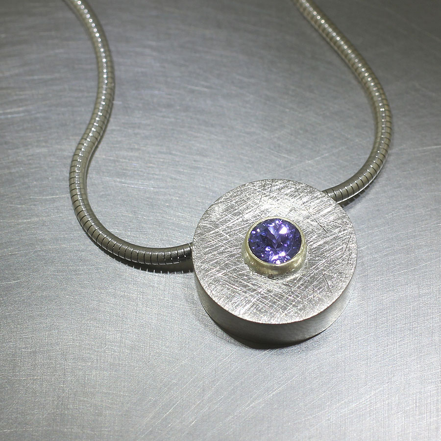 Item #23410440: Tanzanite Circle Pendant with Scratch Finish, 14kt White Gold