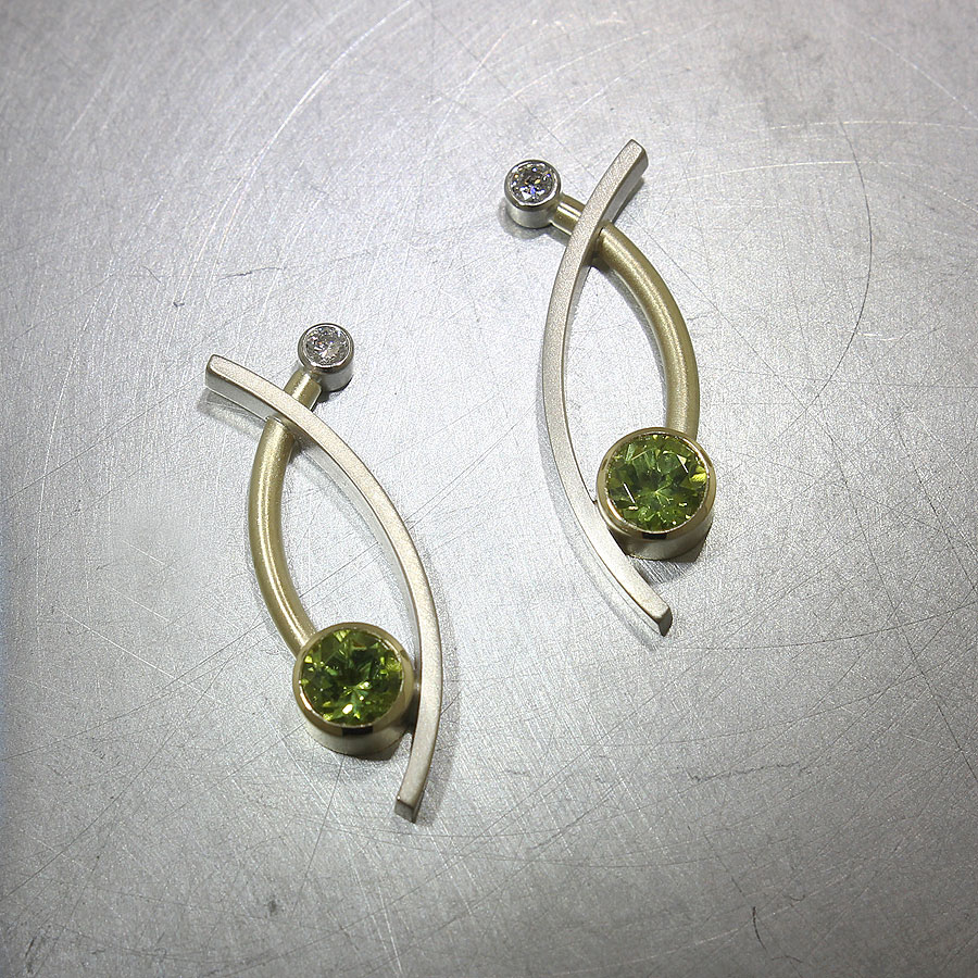 Item #23310924: Curved Sheet & Wire Earrings with Bezel-Set Peridots & Diamonds, 18kt Yellow & 14kt White Gold