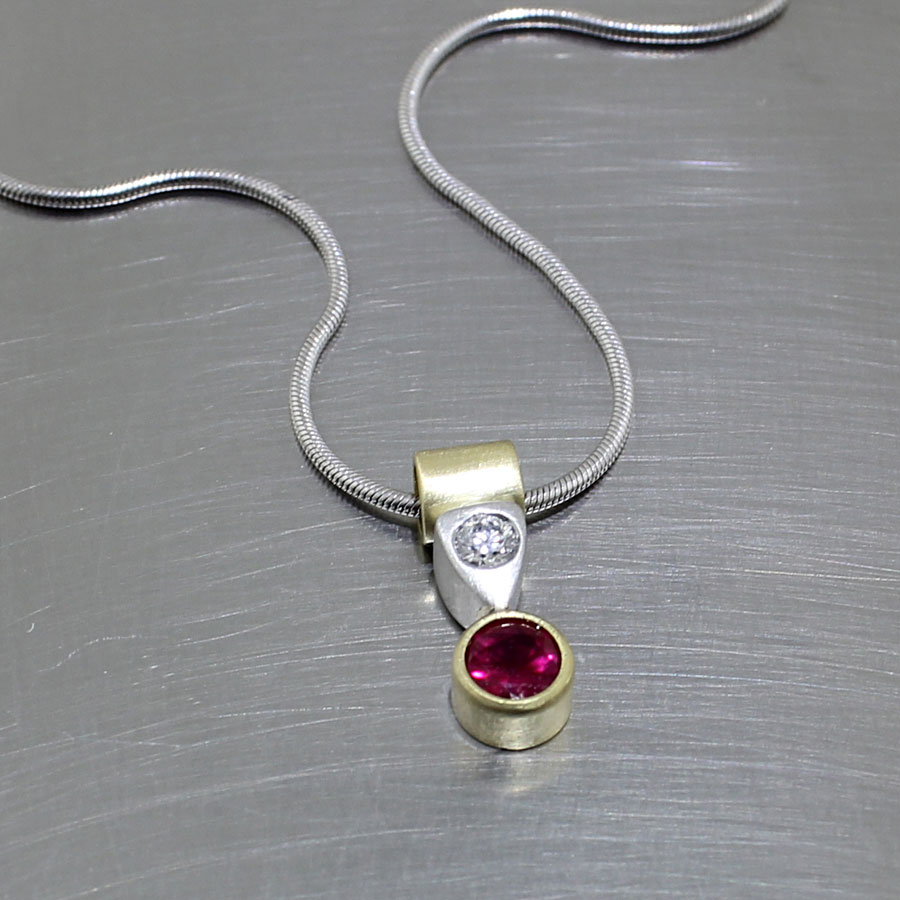 ITEM #27410037: PLATINUM AND YELLOW GOLD BEZEL-SET RUBY PENDANT W/ FLUSH-SET DIAMOND ACCENT AND TUBE BAIL