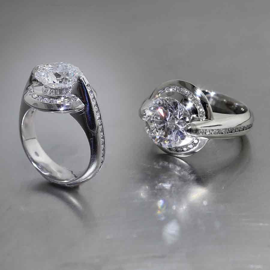 Style #22010520: Floating 3.18ct Round Brilliant Diamond Halo Engagement Ring w/ Channel-Set Diamonds Down Each Side, Platinum