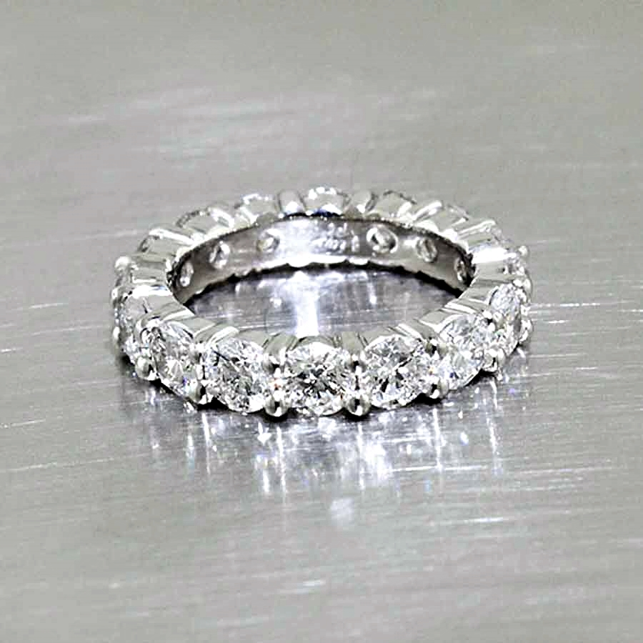 Style #11110255: Diamond Share-Prong Eternity Band in Platinum