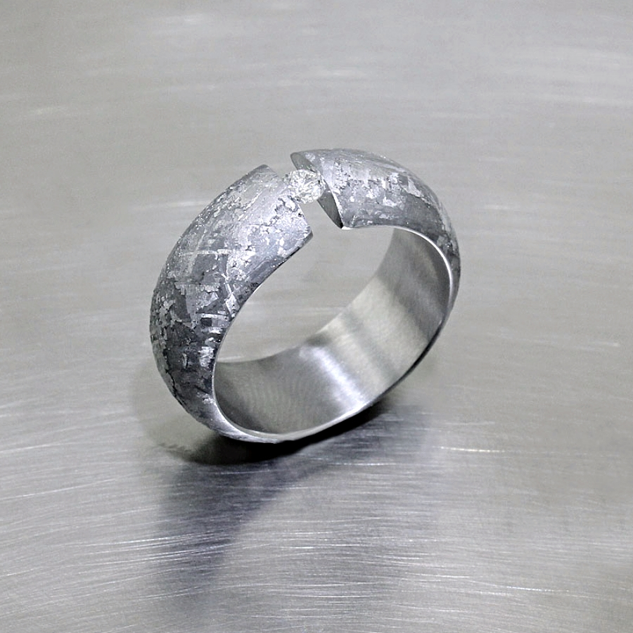 Style #21110098: Domed Meteorite Band Featuring a Tension-Set Diamond