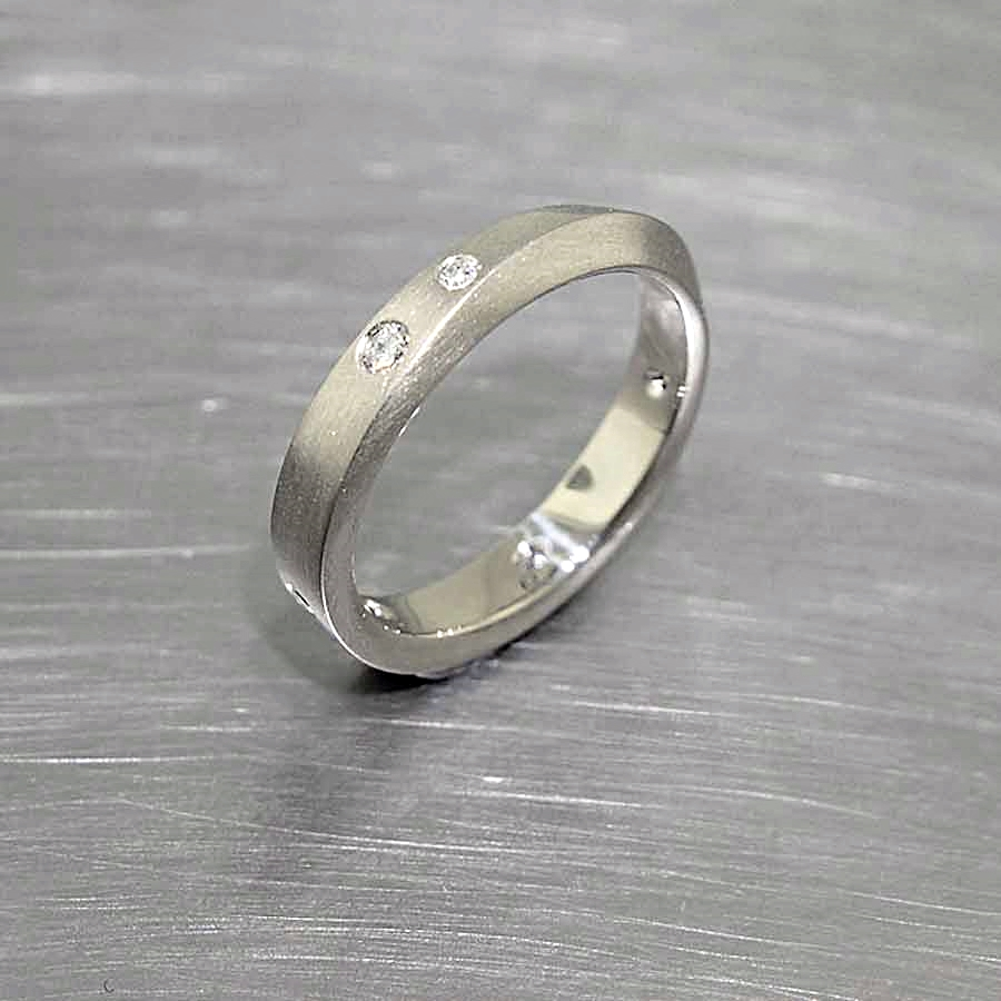 "Style #10111903: ""Mobius Strip"" Diamond Band in White Gold"
