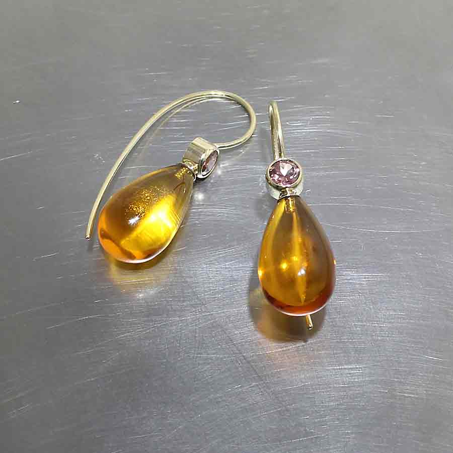 Style #23310998: Exotic Polished Amber Briolette Drop Earrings w/ Round Faceted Cinnamon Zircon Accents, 18KY Gold