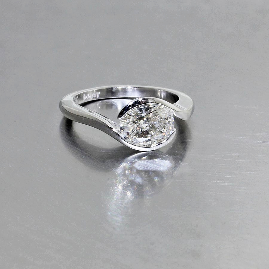 Style #22010530: Platinum Bypass Solitaire Featuring a Sparkling Oval-Cut Diamond