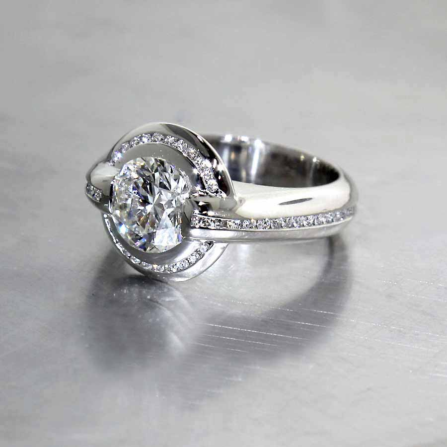 "Style #22010518: Bold, Glamorous Spin on the Classic Diamond ""Halo"" Ring, Platinum"