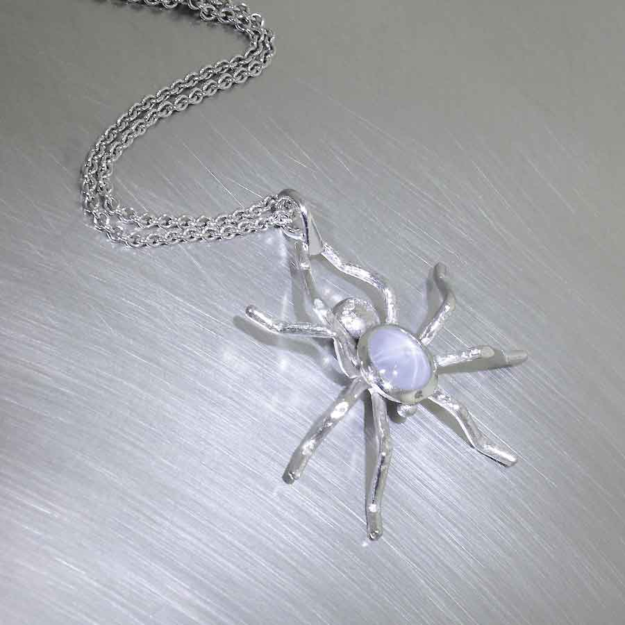 Style #22810158: Exquisitely Detailed Star Sapphire & Diamond Spider Pendant, Platinum