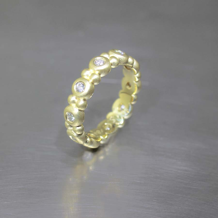 "STYLE #21110099: STACKABLE BEZEL-SET DIAMOND ""BUBBLE"" ETERNITY BAND, 18KY GOLD"