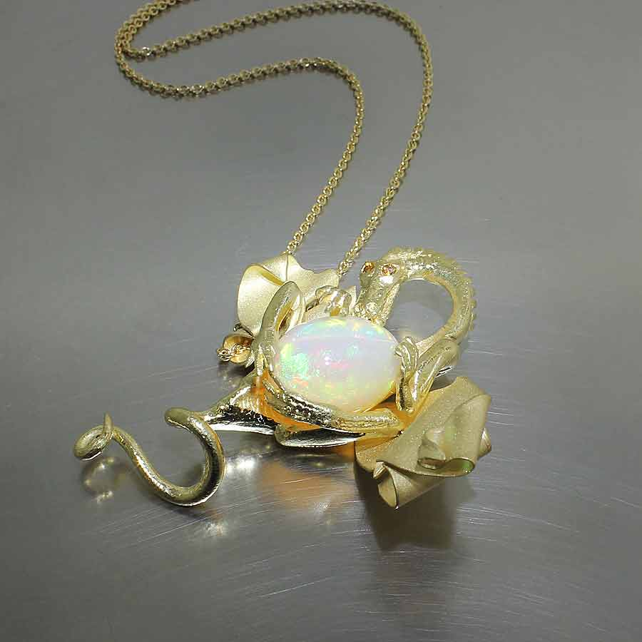"Style #26210090: Dragon Pendant Showcasing a Singular 14.62ct Ethiopian Opal ""Egg"" & Fancy Orange Diamond Eyes, 18KY Gold"