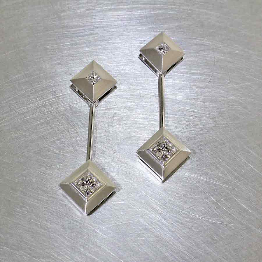 Style #22110564: Streamlined Swinging Pendulum Drop Earrings Featuring Princess-Cut Diamonds, Platinum