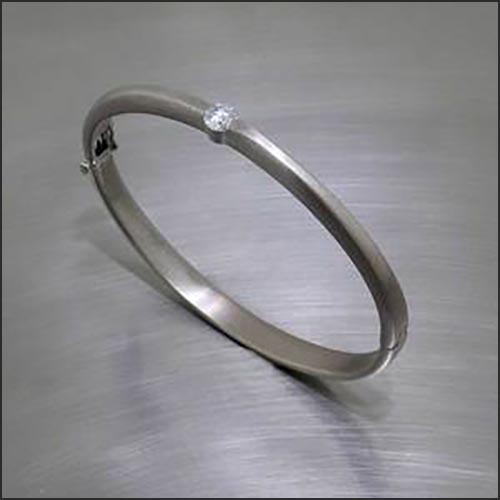Item #22310141: Tapered Bangle with Hinge Mechanism and Single Sparkling Diamond, 18KT White Gold