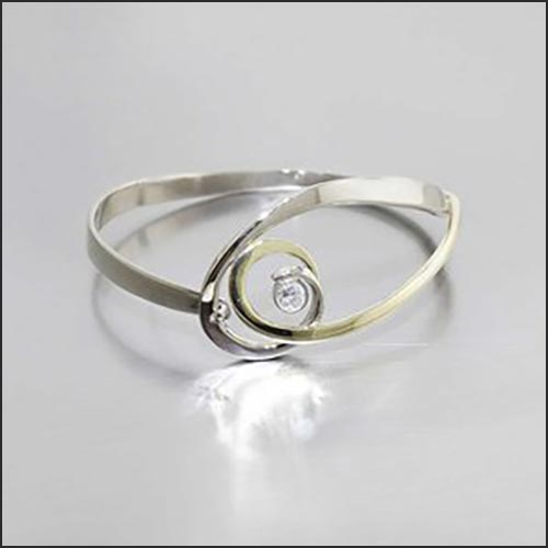 Style #22310150: Feminine Swirling Wire Bangle w/ RBC 0.35ct Diamond, 18KY & 14KW Gold