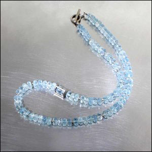 "STYLE #23610130: ICY BLUE STRAND OF FACETED AQUAMARINE RONDELLE BEADS PUNCTUATED BY MODERN, OFF-CENTER BEAD ""CAGE"" & TUBE SPACERS, 16-INCH INCLUDING 14KW GOLD"