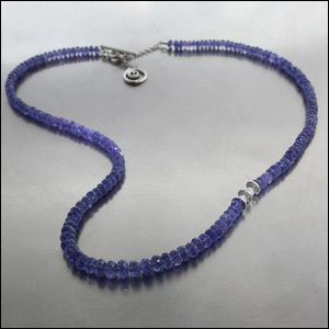 Style #23610127: Mesmerizing 59CT Strand of Shimmering Tanzanite Beads w/ Faceted White Diamond Accents, Platinum