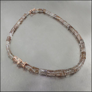 Item #23610098: Rutilated Quartz Barrel Strand with Rose Gold Cutout Spacer
