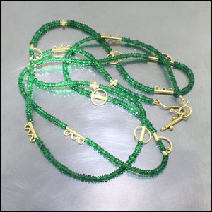 Item #23610099: Long Strand of Tsavorite Garnet Faceted Beads with 18kt Yellow Gold Spacers