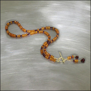 Style # 23610081: Multi-color Garnet Bead Strand with Versatile Toggle Clasp and Bead Drops That Can Be Worn in Front as a Pendant or in Back