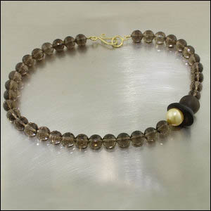 Item #23710299 - Smoky Quartz Bead Strand w/ Golden Pearl