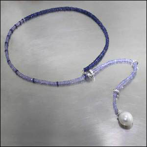 Style #23610119: Elegant Colorblock Strand of Sapphire & Tanzanite Beads Accented by Diamond-Studded Rondelles & South Sea Pearl Drop