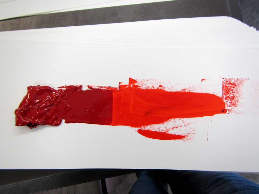 The drawdown test applied to a hand-mixed ink: the two reds are made from the same ink.