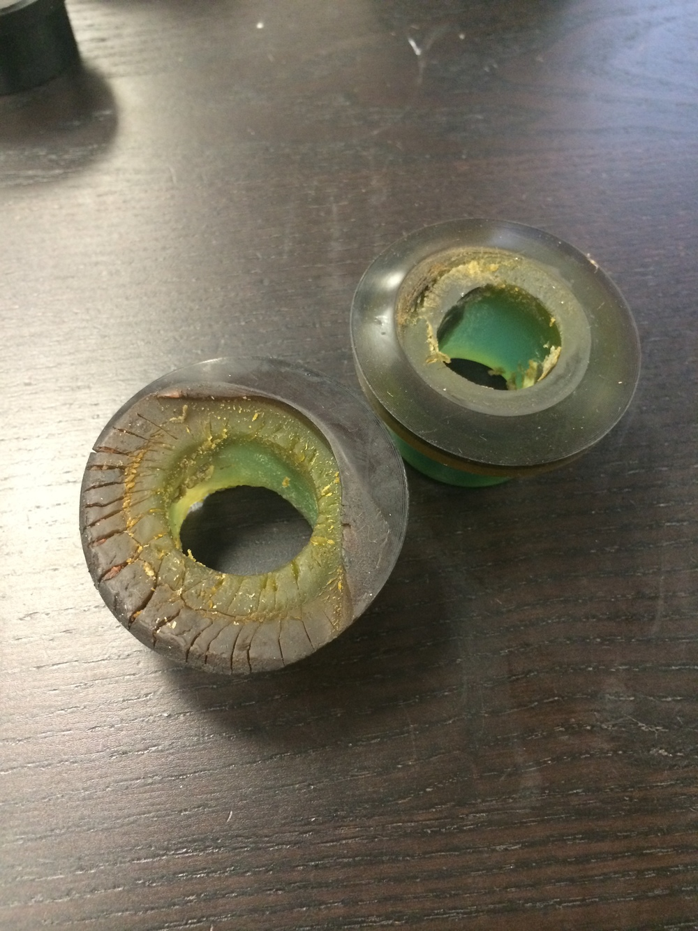 Up close look at  old  Street Grade polyurethane bushings that succumbed to heat in the field.