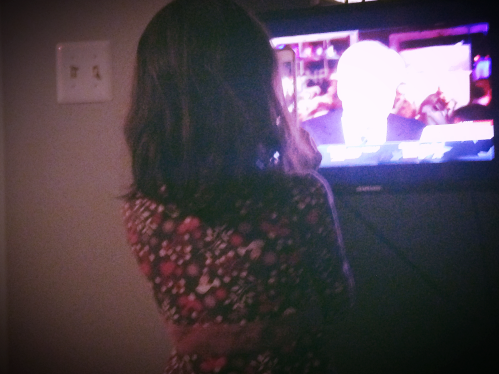 My daughter, watching Chris Matthews on MSNBC.