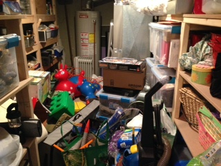 This was once a lovely room of neatly shelved storage items. Now it's where we try to fit more of things we're trying to hide from view.