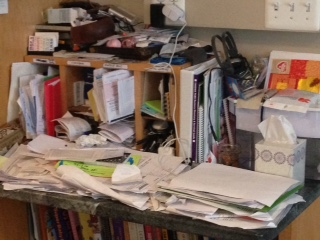 This is always like this. It's where the papers go. They may fly off the desk as the kids run by, but we just put them back up there. Twice a year, we get to the bottom of this mess and vow it will never look like this again.