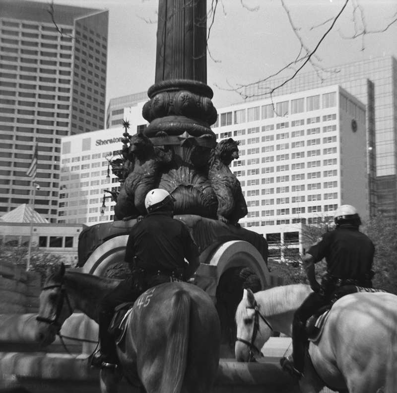 Cops patrolling on horseback around Monument Circle Diana F+