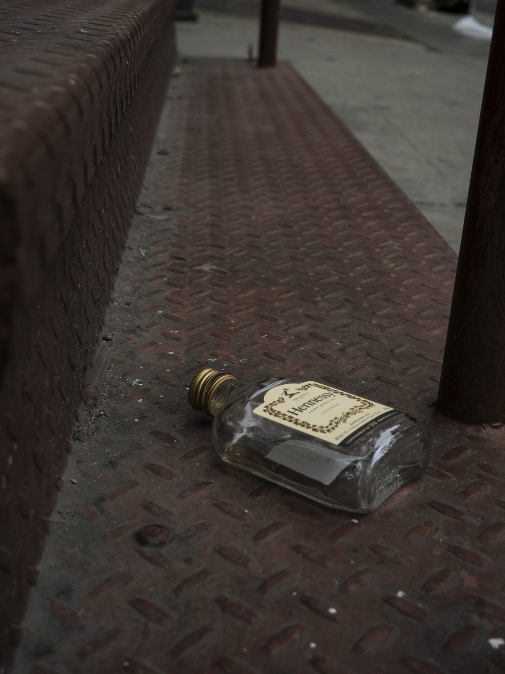 Abandoned Hennessy bottle in SoHo