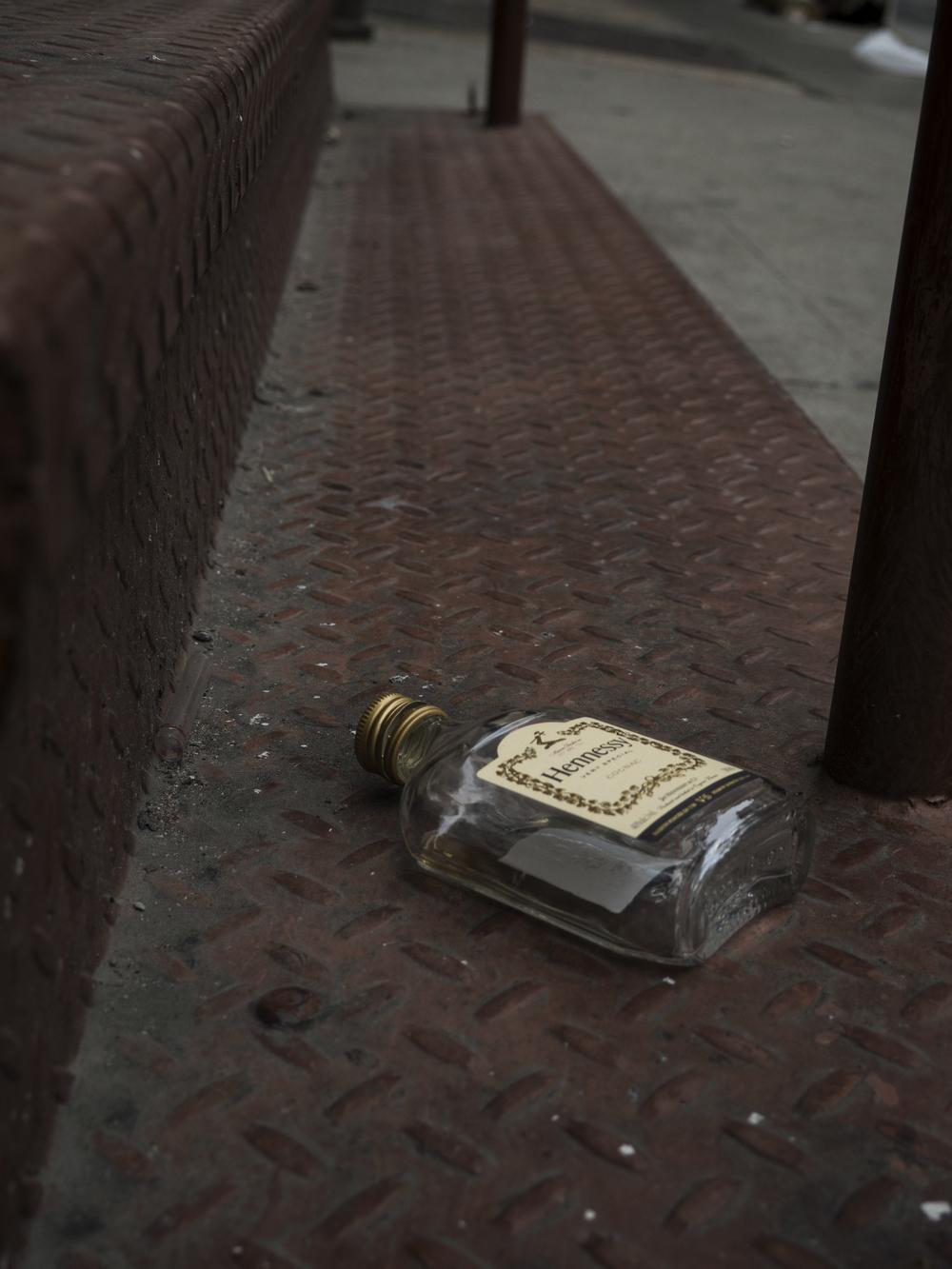 Abandoned Hennessy bottle in SoHo