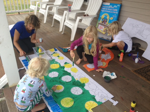 Kids (and Sage!) painting the lemonade stand for the party. Proceeds went to the Alliance for a Healthier Generation. They raised $101!
