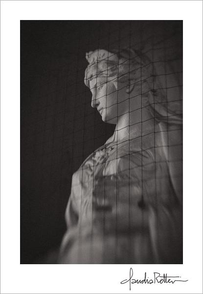 Statue behind wire