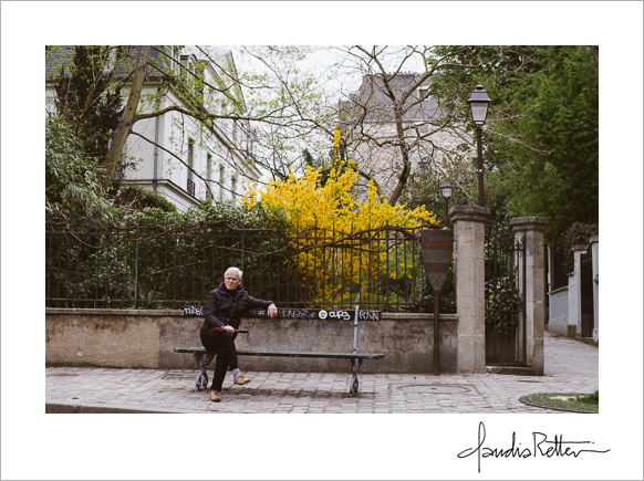 Man on bench with flowers