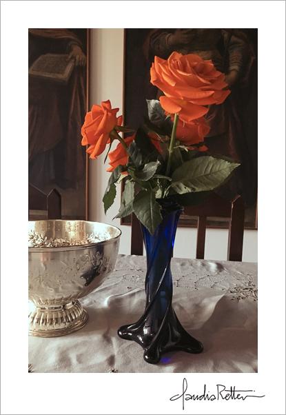 Orange roses, blue vase