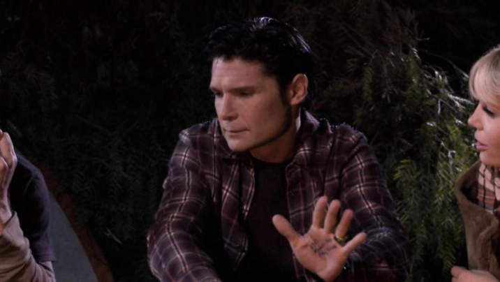 Are those crib notes on Corey Feldman's hand?