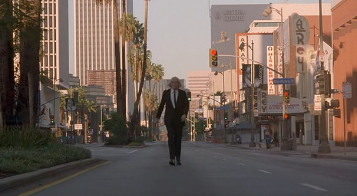 "The Tall Man in front of L.A.'s El Rey Theatre.  Note the ""Dunsmuir"" street sign.  Dunsmuir House near Oakland was the original shooting location for Morningside Mortuary.  Coincidence or Easter egg?"
