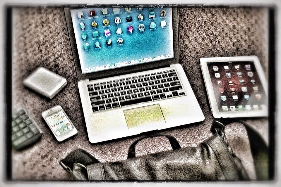 "Want to know what the iPhonaddict carries in his travel tech bag? MacBook Air 13""  ""New"" iPad 16GB WiFi (in White) with gray SmartCover iPhone 4S 16GB (in White) Western Digital 1TB External Drive (which contains my entire iTunes library) And of course....my number keypad. You know how I love my spreadsheets. Not displayed in photo: power cable, sync cable, set of Apple earbuds, and a lint free cloth for keeping it all wiped down. I like to travel light and my Kenneth Cole laptop bag forces me to travel light with minimal tech but with maximum performance."