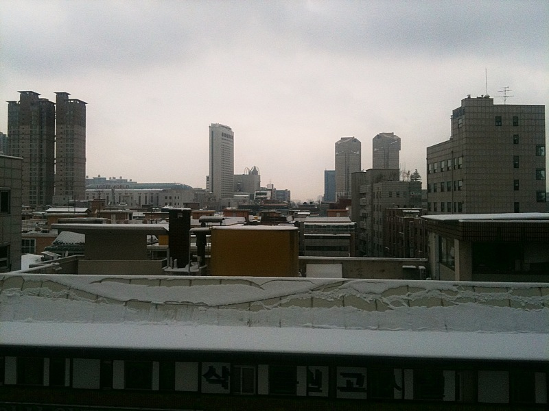 Another view of the snow. This time looking out over the rooftops over Songpa, South Eastern Seoul.   Sent from my iPhone