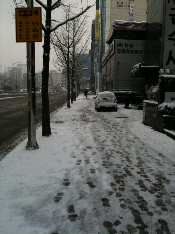 It's almost the middle of March and the snow is falling in downtown Seoul.   Unbelieveable   Sent from my iPhone