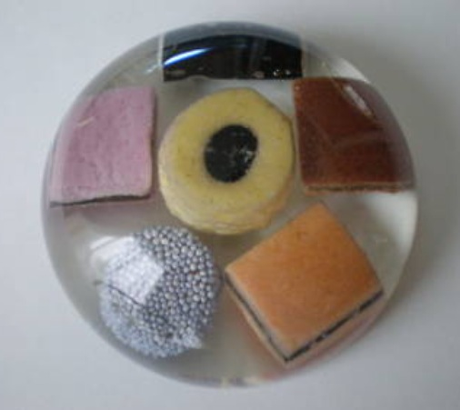 Objects Trapped in Perspex as Paperweights