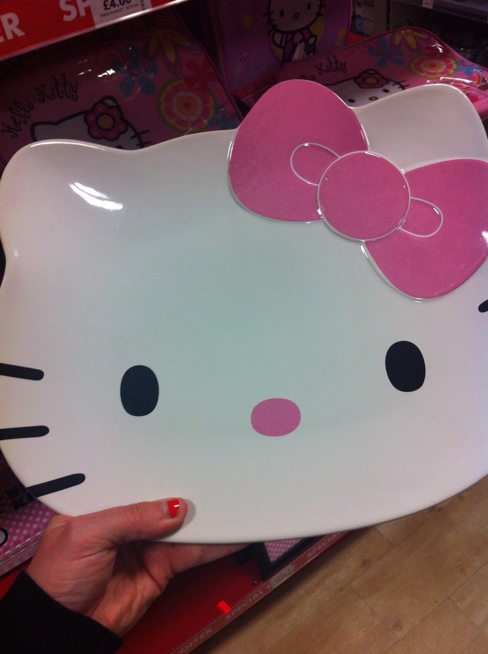 Hello Kitty ceramic plate. It's huge. You could use them as part of a full-size dinner service, if you were as weird as me.