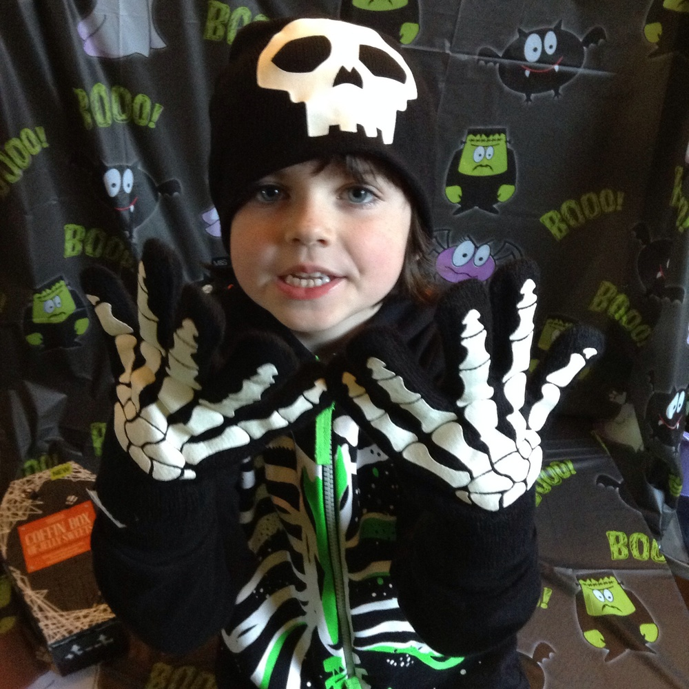 Skull hat and gloves £12 This is his 'hurry up and let me eat the sweets, mummy' face
