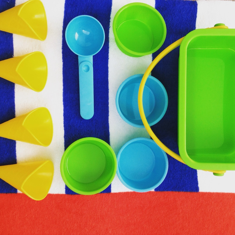 I REALLY like this sand box kit. You can pretend to serve up sand ice creams!