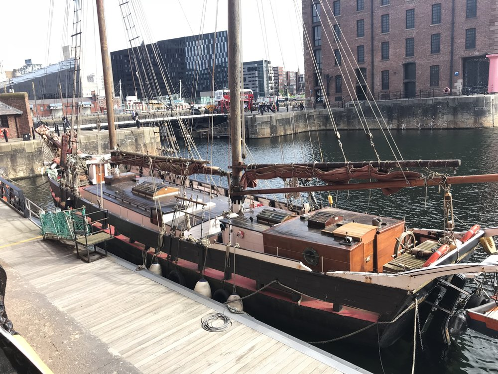 Cool old sail boat inside the dock
