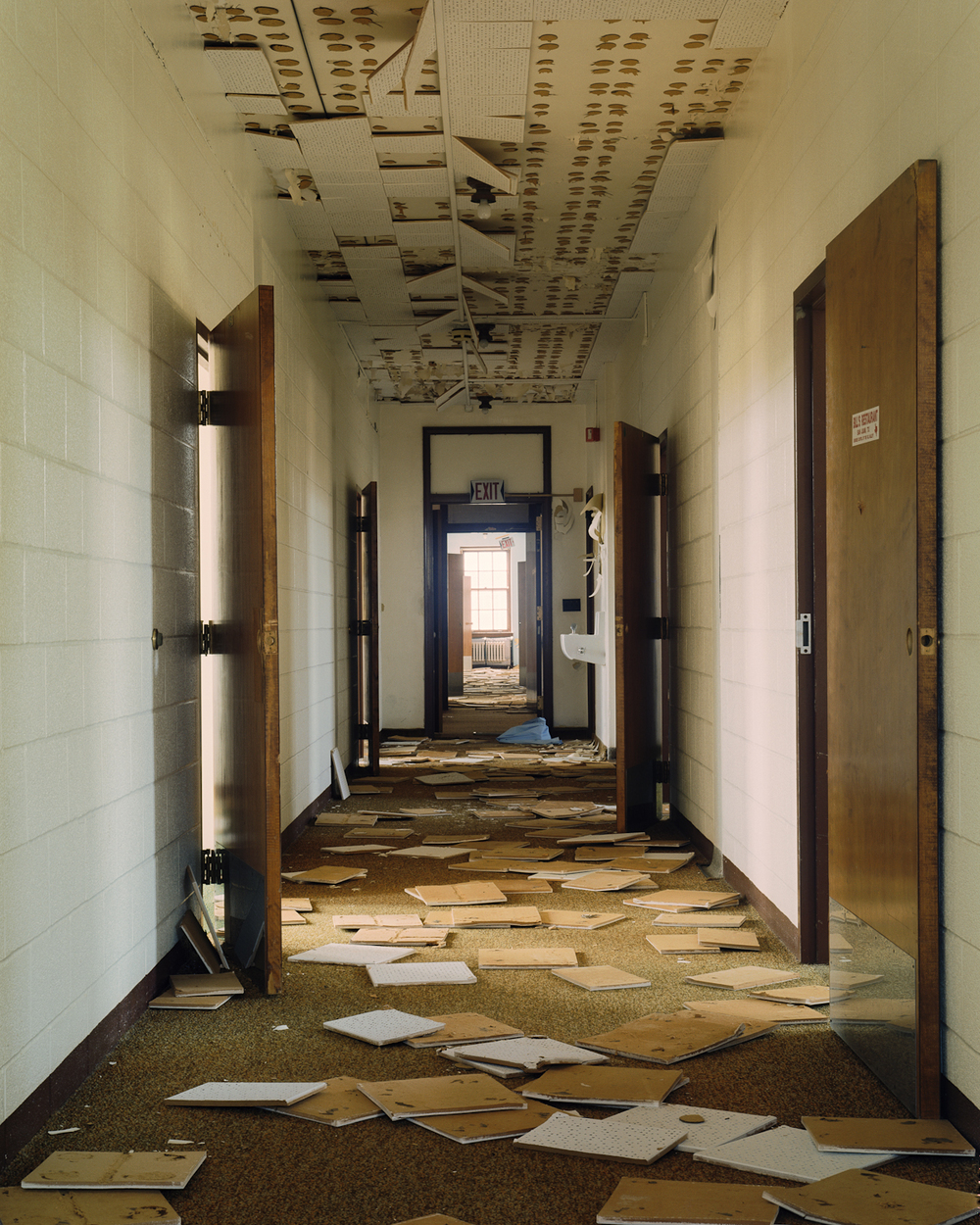Hallway with fallen ceiling tiles, Cottage 4.