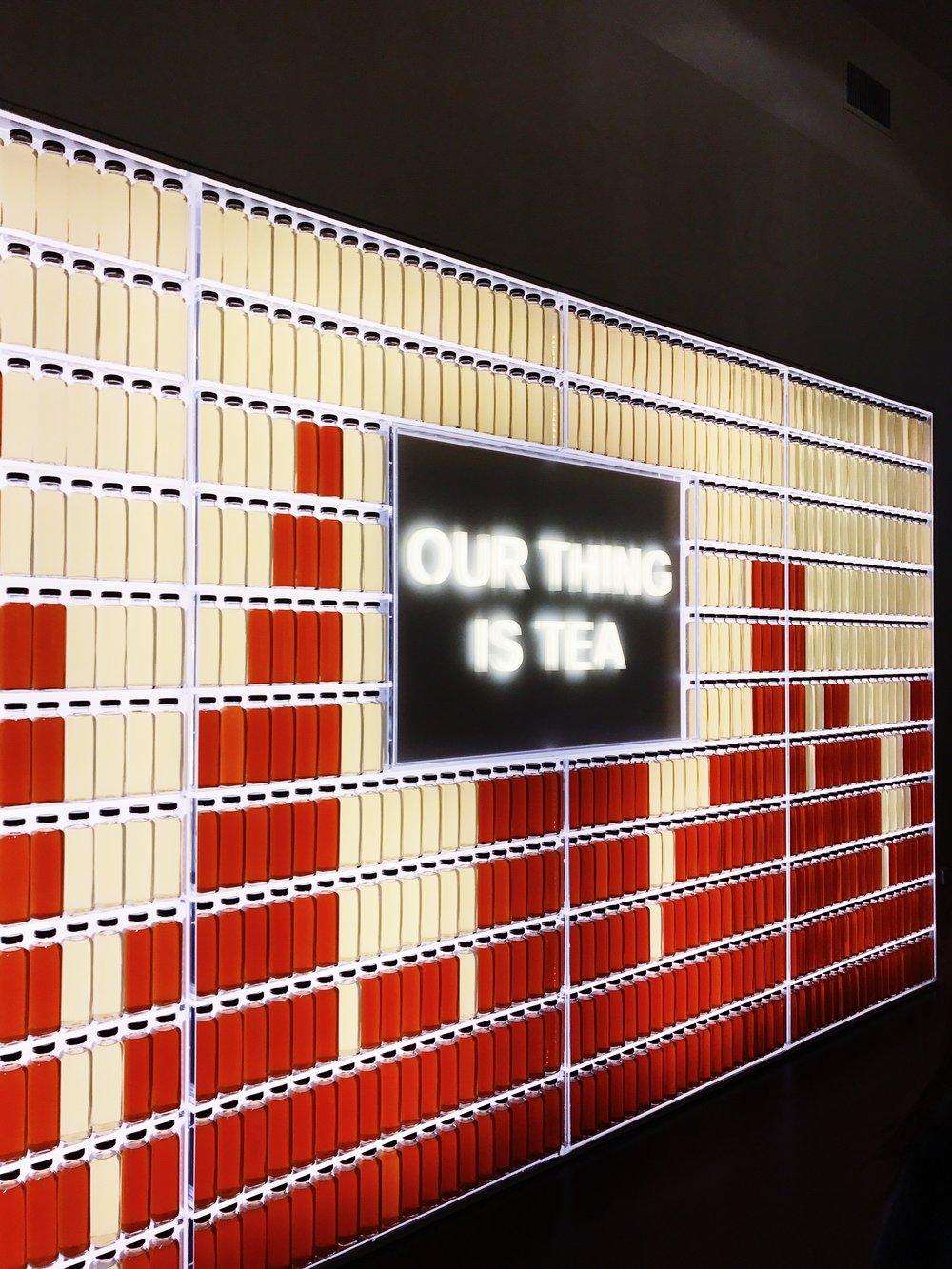 pure leaf tea house nyc tea bottle wall installation