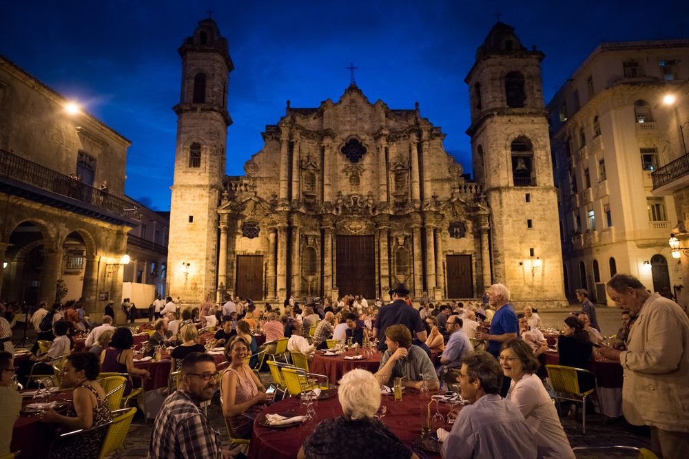 Orchestra members enjoy a dinner served in the Plaza de la Catedral in the center of Old Havana, Cuba.
