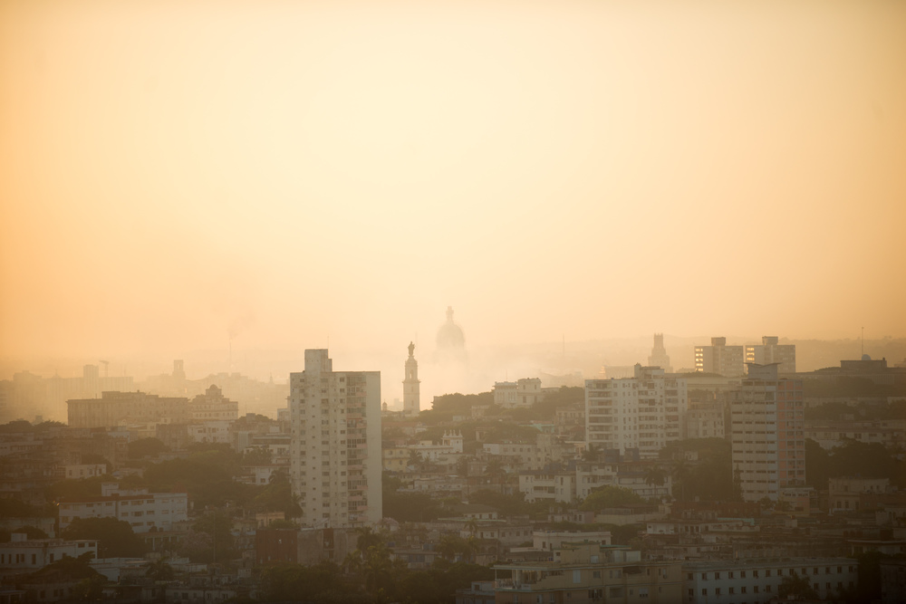 Sunrise over Havana, with the old capital building at the center.